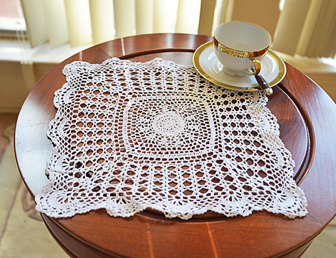 "crochet square placemat. 13"" square. white color."