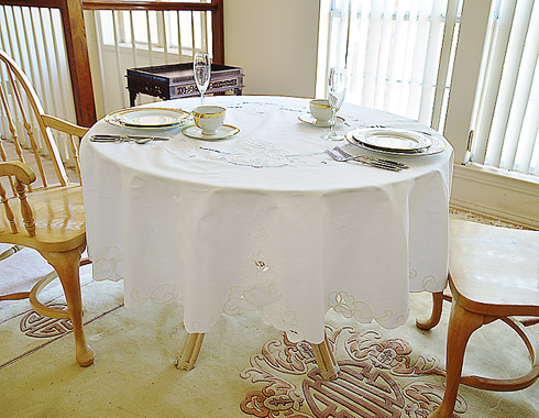 "Imperial fine embroidery round tablecloth. 68"" x 68"" Round."
