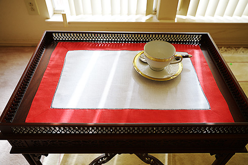 Place Mat. Red colored trimming.