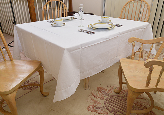 "Festive square tablecloth. White 70""square"