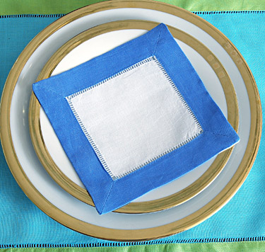 Festive colored trimmed cocktail napkin. French Blue colored
