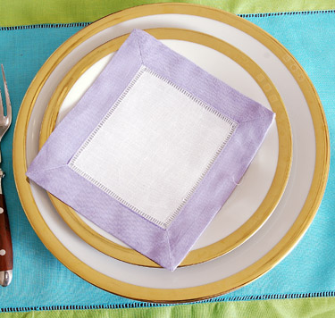 Festive colored trimmed cocktail napkin. Lavender colored