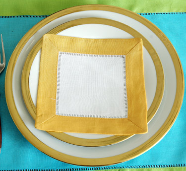 Festive colored trimmed cocktail napkin. Honey Gold