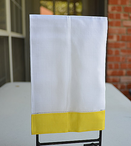 Guest towel. White with Yellow color border