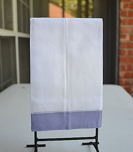 Guest towel. White with lavender color border